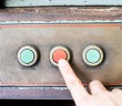 Finger press rustic control panel of old machine,grunge object